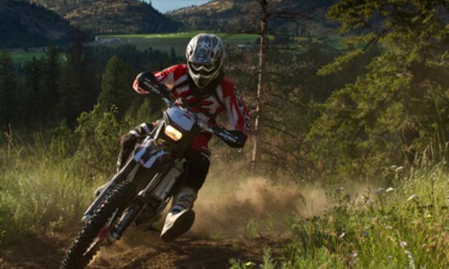 A motorcycler rides a trail in the Okanagan.