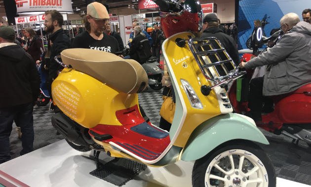 2020 Vespa Sean Wotherspoon Special Edition scooter is mostly yellow with red and turquoise colour scheme.