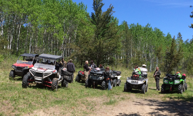 Woodridge Sandhogs have their ATVs parked trailside while out on a local ride.