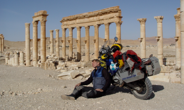 Glen Heggstad rests in the Roman ruins at Palmyra, Syria