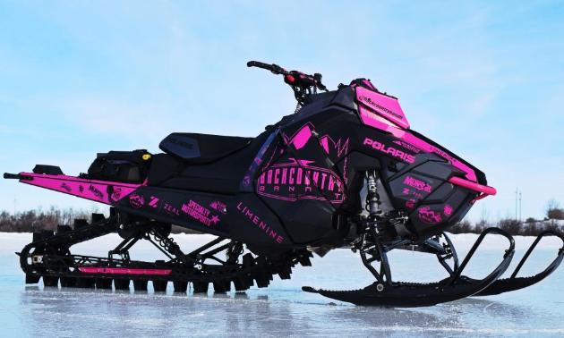 Backcountry Bandit Inc shows off a slick pink on black sled skin.
