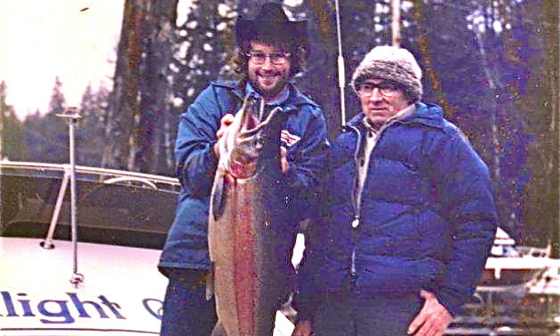 Lex and Fred Jones hold a large trout in an old photo.