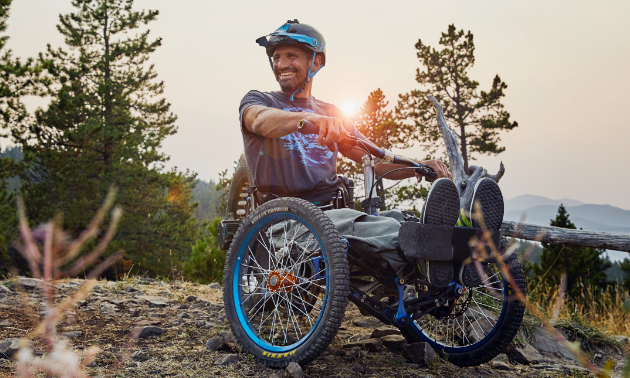 Christian Bagg sits on his Bowhead Reach trike at sunset.