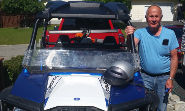 Dennis Saarela stands next to his 2014 Polaris RZR 800 in his driveway.