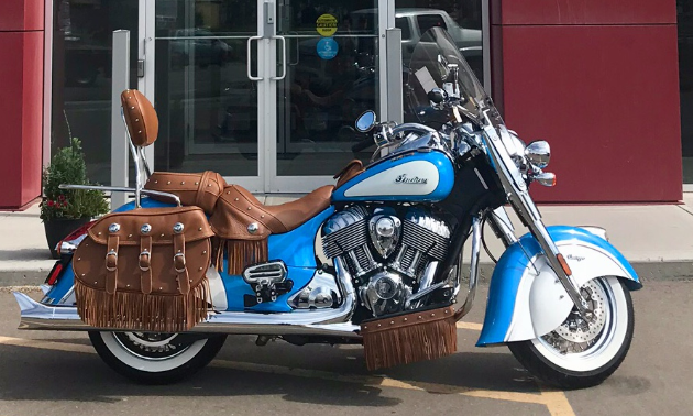 A baby blue Indian motorcycle.