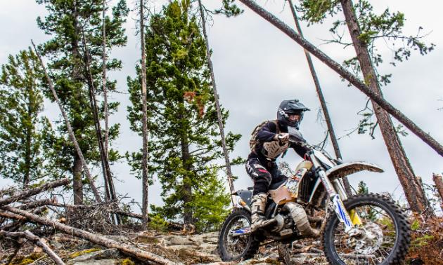 Dustin Labby rides his KTM enduro bike in upper Inks Lake in Kamloops.