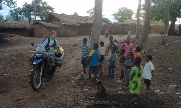 Glen Heggstad gave local youngsters motorcycle rides upon arrival at a Malawi village.