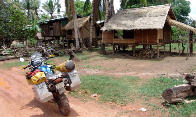 Those willing to travel the world via motorcycle will get to see unique locales, such as this Laotian village.