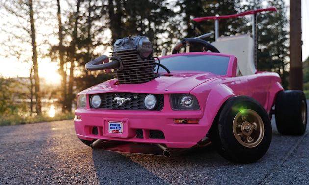 A pink Power Wheels Barbie Mustang with a BR VZ21 mini turbo charger.