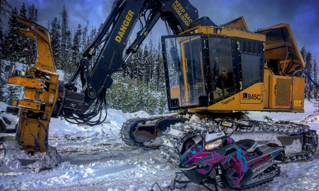 Hannah Dehoog operates a Tigercat LX870C for logging and commutes to work via her 2015 Polaris 800 Assault with GGB exhaust.