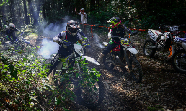 Dirt bike riders are battling for position during the Kirk