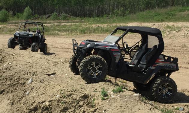 An ATV idles on rocky terrain.