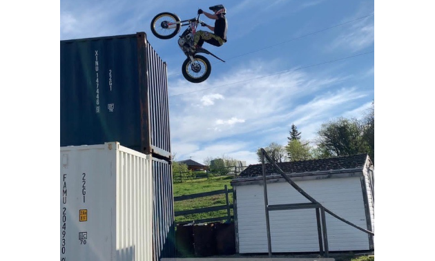 Sam King jumps onto two shipping containers on his dirt bike.