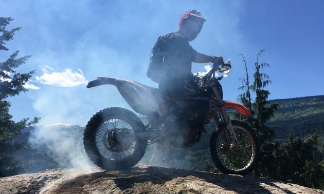 Shawn Handley burns rubber on a big rock.
