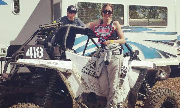 Sheldon and Jayden Baynham pose with a trophy on Jayden's white RZR XP 1000.