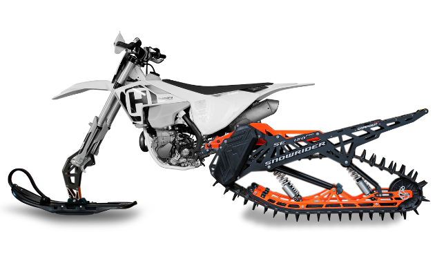 A side view of a white and orange snow bike.