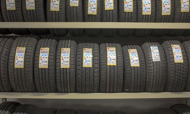 Several rows of tires on a rack.