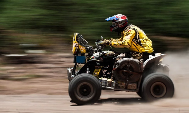 An ATVer becomes a blur as he races his quad.