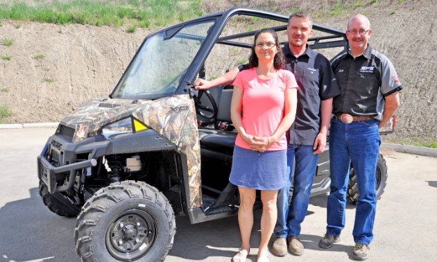 (L to R) Tracy and Heino Seibert, owners of Spectra Power Sports, and Scott Fraser, general manager of Spectra Power Sports.
