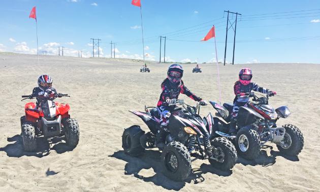 Kids ride ATVs