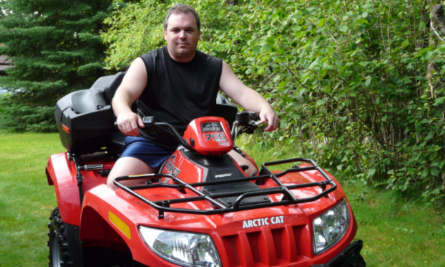 Armando Brambilla sits on top of his ATV