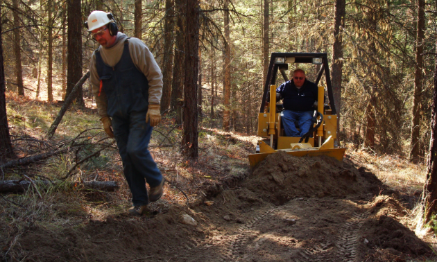Mini bulldozers pave the way for new trails at the Bear Creek Recreation Site.