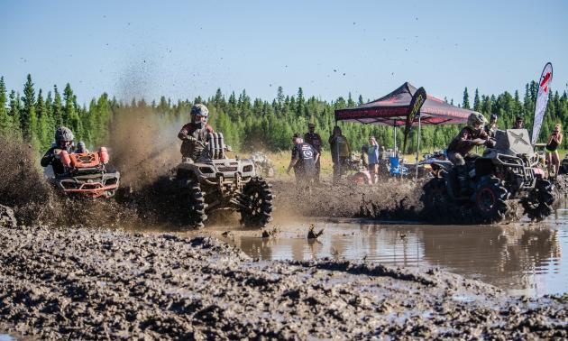 ATVs race through mud