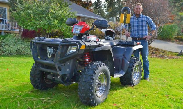 David Sullivan stands next to an ATV with a Quadbar