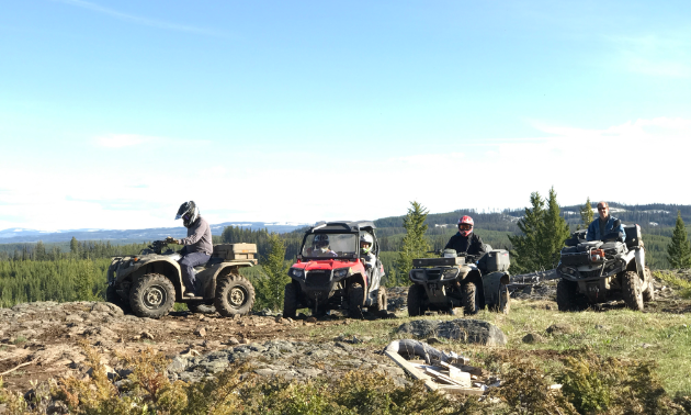 Riders sit on their ATVs in Vernon
