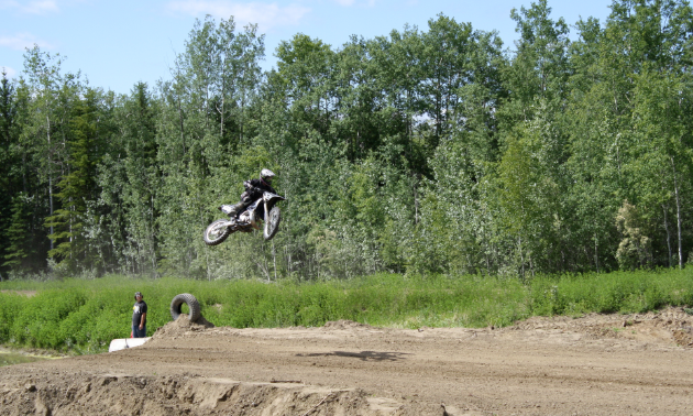 A rider takes to the air after a big jump.