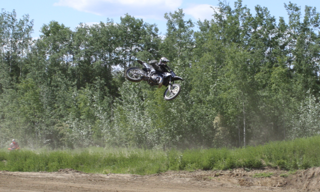 A motorcycle rider takes to the air in High Level