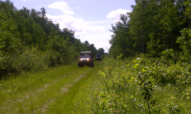 An ATV drives on Interlake Pioneer Trail