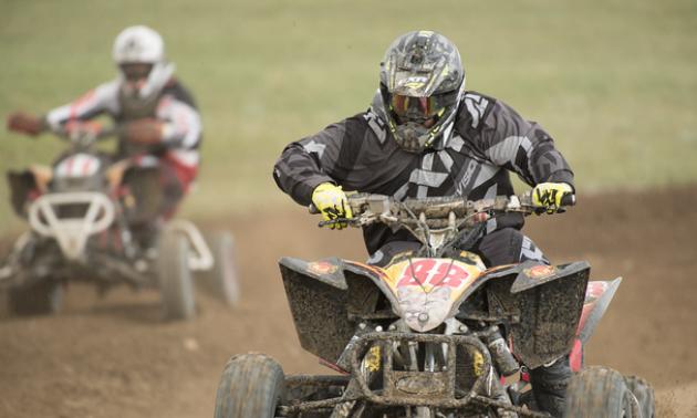 Jason Stapleton rides his ATV in a race