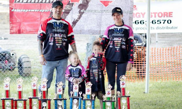 (L to R) Bill, Brook, Damon and April Ford are one big happy mud-racing family.