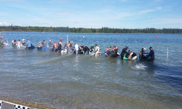 PWC riders prepare for a race to begin at Crane Lake, Alberta.