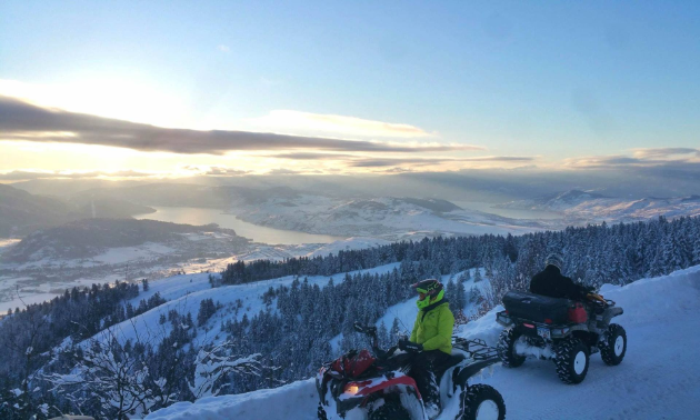 An ATV and rider look out over the horizon