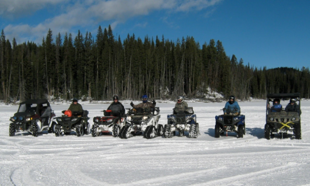 ATV riders line up to pose for a picture