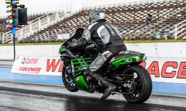 Chris Klassen racing down the drag strip on his Kawasaki.