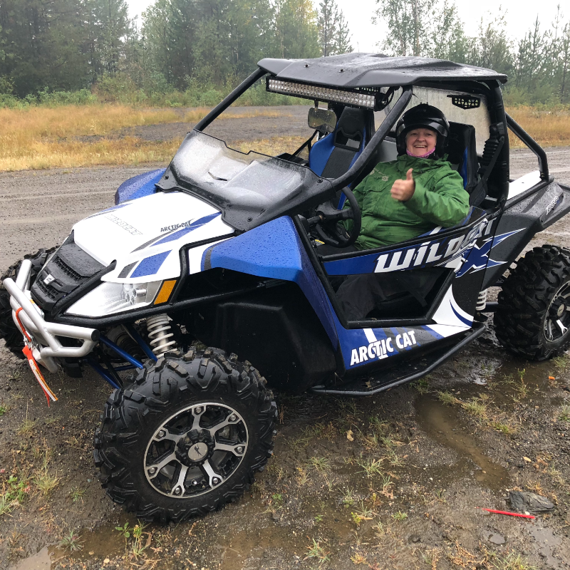 Nycole Ross rides a souped-up Arctic Cat Wildcat 1000 X, outfitted with a winch, hard roof, front and back extended fenders, LED light bar, extra brake light and rear backup lights, rock guards/sliders, bottom doors, upgraded steering system, front and back bumpers, front and back windows, rear storage cargo box, upgraded tires, and a Garmin GPS.