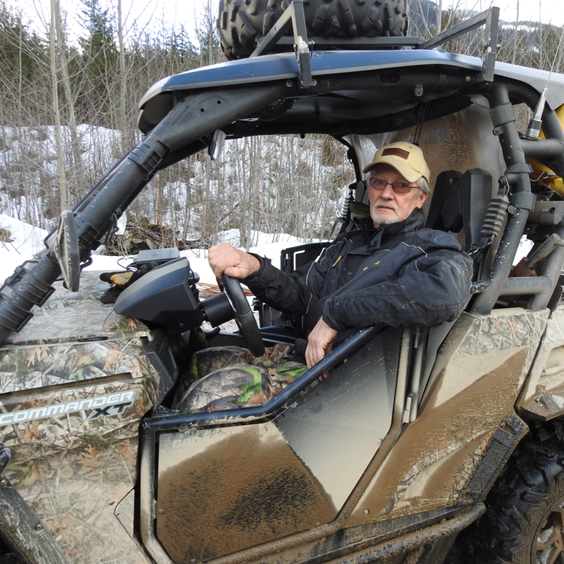 Ron Laroy relaxes inside his dirty Can-Am Commander 1000.