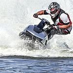 A picture of a man riding his personal water craft.
