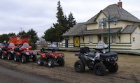 4 Quads in front of the old rail station at Smoky Lake.