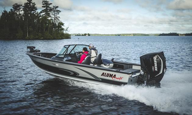 Two people in an Alumacraft boat.
