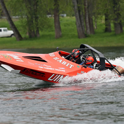 Chad Burns is driving his red jet boat.