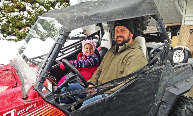 Chris Pylatuk sits in his UTV with his riding buddy, his five-year-old daughter, Lyla.