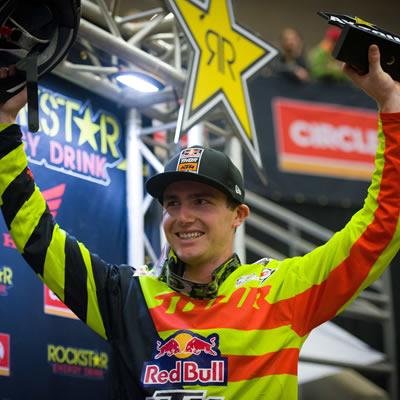 Cole Thompson celebrating on the podium.