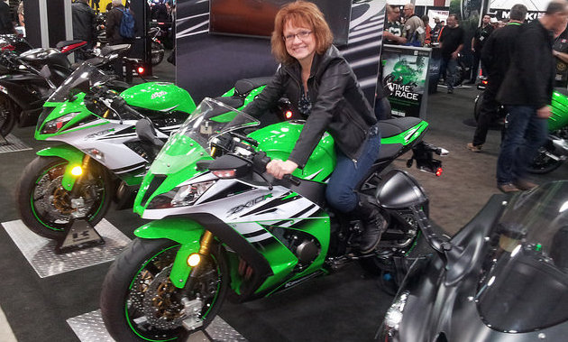 Corinne Laycock sitting on a bike at the Vancouver Motorcycle Show.