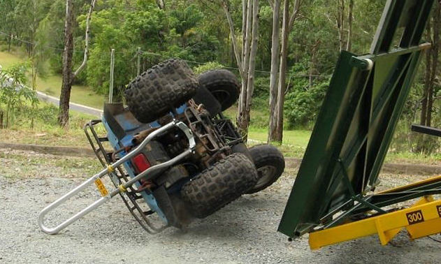 A rollover test of the Quadbar, showing the life-saving space underneath the ATV.