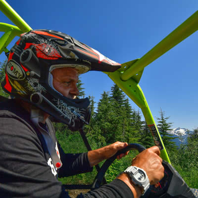 Daniel Kellie, owner of Glacier Mountain Resort, riding in his ATV
