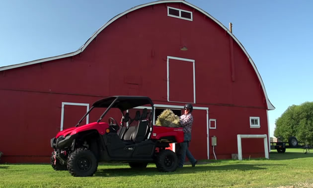 Darryl Sutter on his farm with the Yamaha Viking side by side